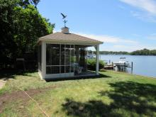 14' x 14' vinyl pavilion with slider screens by lake