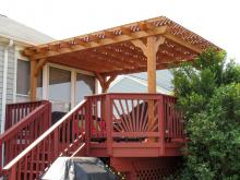 traditional style wood pergola on deck with lattice roof